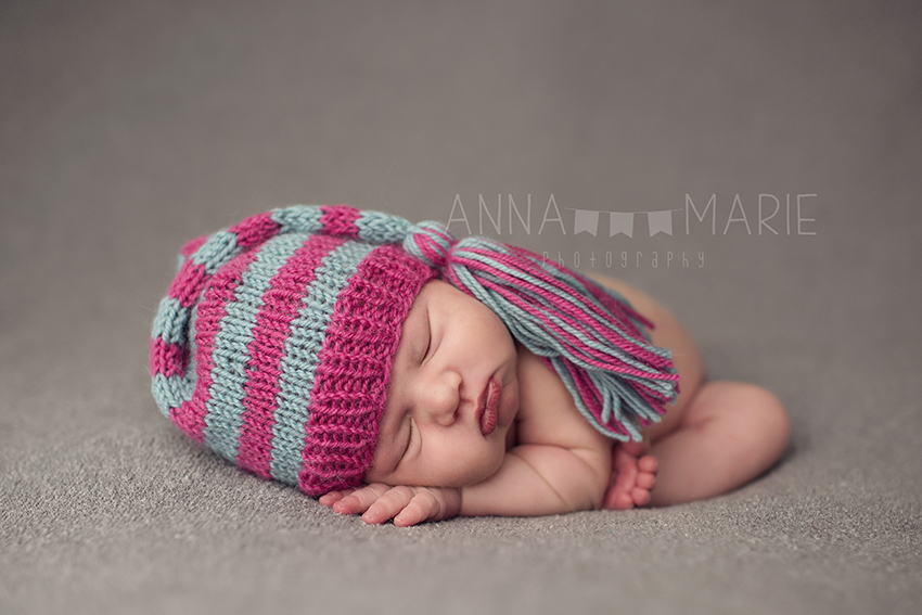 Independence Newborn Photographer baby with pink and blue sleeping cap